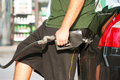 Pumping gasoline into a car Royalty Free Stock Image