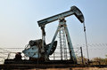Pumpjack pumping crude oil from oil well old Royalty Free Stock Photo