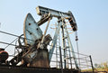 Pumpjack pumping crude oil from oil well old Stock Photo