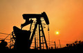 Pumpjack pumping crude oil from oil well old Royalty Free Stock Photos