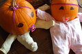 Pumpkin babies from above two pumpkins dressed up as princess with pacifiers seen Stock Photos