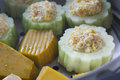 Pumpkin and bitter melon stuffed with vermicelli, tofu, corn and carrot while steaming in steaming pot Royalty Free Stock Photo