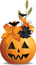 Pumpkin bouquet a halloween floral arrangement in a happy jack o lantern Royalty Free Stock Image