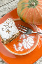 Pumpkin cake on orange plate decorated with pattern from the series Royalty Free Stock Images
