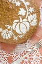 Pumpkin cake on red background decorated with pattern from the series Stock Image