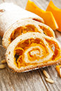 Pumpkin cake roll roulade with chopped Stock Photos