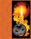 Pumpkin with candle and maple leaves. Halloween Stock Photography