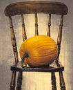 Pumpkin on chair large rustic country house Royalty Free Stock Images