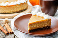 Pumpkin cheesecake decorated with whipped cream the toning selective focus Stock Image