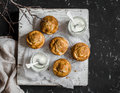 Pumpkin and cream cheese swirl muffins and greek yogurt. Delicious breakfast or snack. On a dark background, top view. Royalty Free Stock Photo