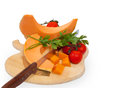 Pumpkin on cuting board Royalty Free Stock Image