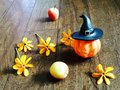 Pumpkin doll and yellow flowers flower on wooden floor Royalty Free Stock Photos