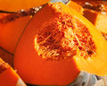 Pumpkin fresh ripe slices at a farmers market Royalty Free Stock Photography