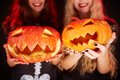 Pumpkin grins photo of carved halloween pumpkins on female palms Stock Photography