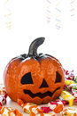 Pumpkin in halloween party picture of a ceramic surrounded by candies Royalty Free Stock Photography