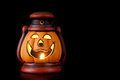 Pumpkin lantern with candle inside lit up in the dark Royalty Free Stock Photography