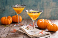 Pumpkin martini cocktail with black salt rim fall seasonal pumpkintini Royalty Free Stock Images