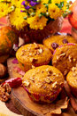 Pumpkin muffins with nuts flowers and in background Stock Photos