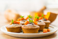 Pumpkin muffins sweet with walnuts and powdered sugar Stock Images