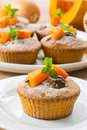 Pumpkin muffins sweet with walnuts and powdered sugar Royalty Free Stock Image