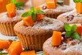 Pumpkin muffins sweet with walnuts and powdered sugar Royalty Free Stock Photo