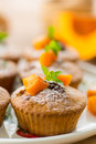Pumpkin muffins sweet with walnuts and powdered sugar Stock Photo