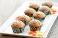 Pumpkin muffins on a tray Royalty Free Stock Photos