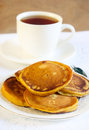 Pumpkin pancakes and cup of tea selective focus Royalty Free Stock Photo