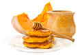 Pumpkin pancakes with honey Stock Image