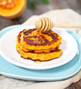 Pumpkin pancakes with honey on the wooden background Royalty Free Stock Photo