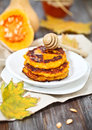 Pumpkin pancakes with honey on the wooden background Stock Images