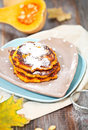 Pumpkin pancakes and on the wooden background Royalty Free Stock Image