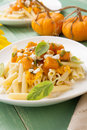 Pumpkin pasta healthy whole grain penne tube shaped with goat cheese sage and pine nuts Royalty Free Stock Photography