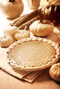 Pumpkin pie with autumn pumpkins and corn Royalty Free Stock Photo