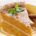 Pumpkin pie with mint garnish. Royalty Free Stock Photo