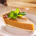 Pumpkin pie with mint garnish closeup close up photo of a single piece of Stock Photos