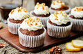 Pumpkin pie spices walnuts banana cupcakes with salted caramel a and cream cheese frosting toning selective focus Stock Photography