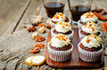 Pumpkin pie spices walnuts banana cupcakes with salted caramel a and cream cheese frosting toning selective focus Royalty Free Stock Images