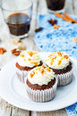 Pumpkin pie spices walnuts banana cupcakes with salted caramel a and cream cheese frosting toning selective focus Stock Images