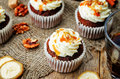 Pumpkin pie spices walnuts banana cupcakes with salted caramel a and cream cheese frosting toning selective focus Royalty Free Stock Photo