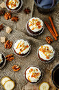Pumpkin pie spices walnuts banana cupcakes with salted caramel a and cream cheese frosting toning selective focus Royalty Free Stock Photos
