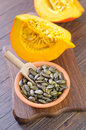 Pumpkin seed and on wooden board Royalty Free Stock Image