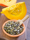 Pumpkin seed and on wooden board Stock Image
