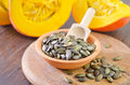 Pumpkin seed and on wooden board Stock Photography
