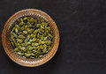 Pumpkin Seeds in a Metal Bowl Royalty Free Stock Photo