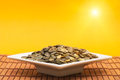 Pumpkin Seeds in Sunlight Stock Photo