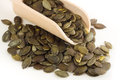 Pumpkin seeds wooden spoon Stock Image