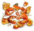 Pumpkin smashed on a white background as a concept and symbol for a halloween bash or harvesting time with broken pieces of orange Royalty Free Stock Image