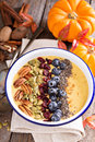 Pumpkin smoothie bowl with chia seeds, pecans, cranberries Royalty Free Stock Photo