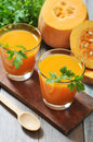 Pumpkin smoothie in glass on rustic wooden background Stock Photos